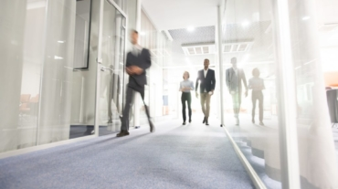business-people-walking-in-office-corridor-1024x682-1